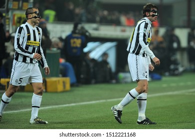 "Milan, 28 January 2010, Stadium ""G.MEAZZA SAN SIRO"", Football Championship  Italy Cup 2009/2010, FC Inter - FC Juventus: Fabio Cannavaro and Zdenek Grygera with protective masks during the game"