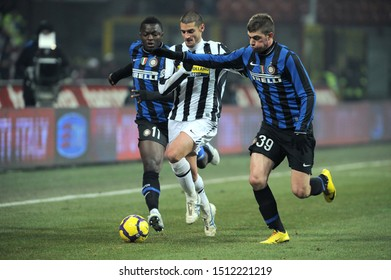 "Milan, 28 January 2010, Stadium ""G.MEAZZA SAN SIRO"", Football Championship  Italy Cup 2009/2010, FC Inter - FC Juventus: Antonio Candreva , Sulley Muntari and Davide Santon in action during the match"