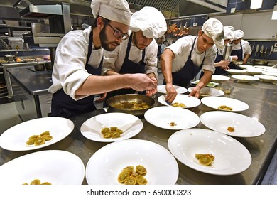 MILAN, APRIL 03, 2017: cooks at work on the Alice italian restaurant, inside the Eataly food store, in Milan.