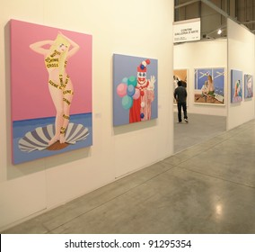 MILAN - APRIL 08: Looking at paintings galleries during MiArt, international exhibition of modern and contemporary art on April 08, 2011 in Milan, Italy.
