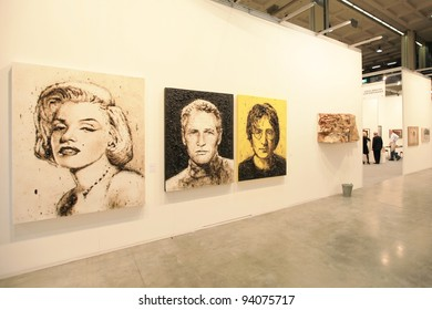 MILAN - APRIL 08: Looking at paintings dedicated to Marilyn Monroe, Paul Newman and John Lennon at MiArt, international exhibition of modern and contemporary art on April 08, 2011 in Milan, Italy.