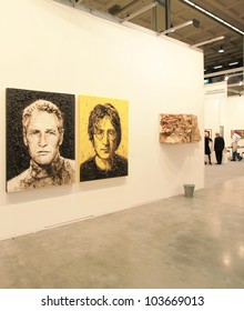 MILAN - APRIL 08: Paul Newmann and John Lennon represented at paintings galleries during MiArt, international exhibition of modern and contemporary art on April 08, 2011 in Milan, Italy