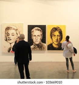 MILAN - APRIL 08: People look at paintings galleries during MiArt, international exhibition of modern and contemporary art on April 08, 2011 in Milan, Italy