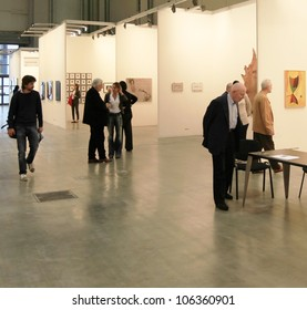 MILAN - APRIL 08: People look at paintings and sculpture galleries during MiArt, international exhibition of modern and contemporary art on April 08, 2011 in Milan, Italy
