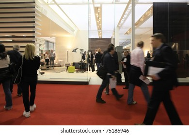 MILAN - APRIL 13: People look at interior design solutions and home architecture decorations at Salone del Mobile, international furnishing accessories exhibition on April 15, 2010 in Milan, Italy.