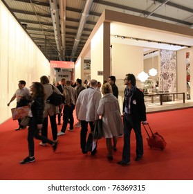MILAN - APRIL 13: People look at interiors design stands and home architecture solutions at Salone del Mobile, international furnishing accessories exhibition on April 13, 2011 in Milan, Italy.