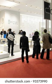 MILAN - APRIL 13: People look at interiors architecture and design solutions at Salone del Mobile, international furnishing accessories exhibition on April 13, 2011 in Milan, Italy.