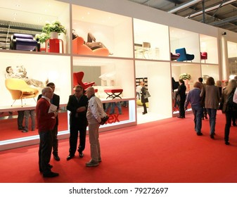 MILAN - APRIL 13: Visitors look at interior design solutions walking trough stands at Salone del Mobile, international furnishing accessories exhibition on April 13, 2011 in Milan, Italy.