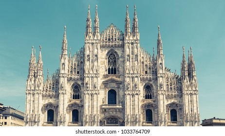 Milan Cathedral (Duomo di Milano), Italy. Milan Cathedral is the fifth largest in the world. Panoramic view of Milan Cathedral in the sunlight. The luxury facade of Milan Cathedral.