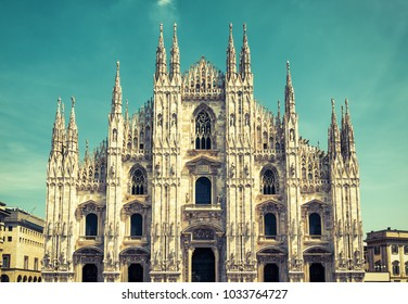 Milan Cathedral (Duomo di Milano), Italy. Milan Cathedral is the fifth largest in the world. Milan Cathedral in the sunlight. The luxury facade of Milan Cathedral. Vintage toned picture.