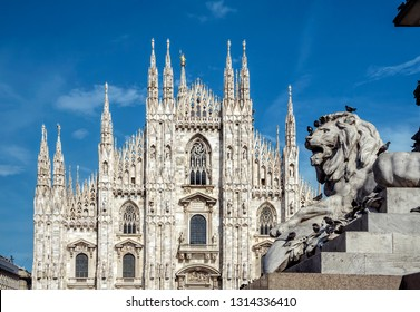 Milan Cathedral (Duomo di Milano) and sculpture of a lion, Milan, Lombardy, Italy. Famous tourist attraction of Milan, Italy.
