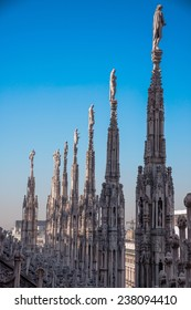 Milan Cathedral (Duomo Di Milano) with statues on the roof in Milan, Italy