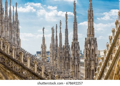 Milan Cathedral or Duomo di Milano, Italy. Detail of the luxury roof. Milan Cathedral is the main tourist attraction of Milan. Ornate Gothic architecture of Milan on blue sky background. Nice view.