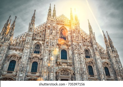 Milan Cathedral (Duomo di Milano) in the sunlight in Milan, Italy. It is the best-known sights of Milan. The beautiful gothic facade of Milan Cathedral on a sunny summer day.