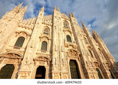 Milan Cathedral, Italy. Gothic style marble church facade. Sunset light.