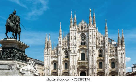 Milan Cathedral and monument to Victor Emmanuel II on the Piazza del Duomo in Milan, Italy. Gothic Milan Cathedral is the main tourist attraction of Milan. Panoramic view of a center of Milano city.