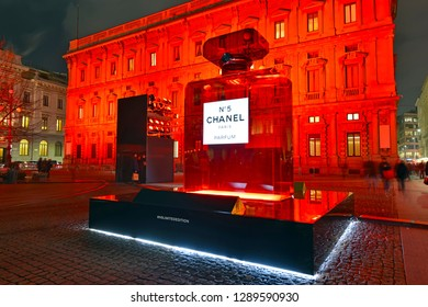 MILAN CIRCA DECEMBER 2018. French fragrance maker Chanel with its Red Limited Edition Number 5 perfume on display with red background attracts tourists in busy shopping center in Milan Italy