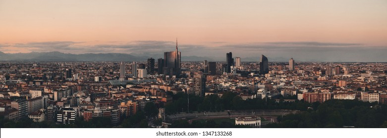 Milan city skyline panorama viewed from above at sunset in Italy.