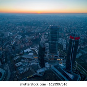 Milan city skyline at sunrise, aerial view. Panoramic view of new skyscrapers in Citylife district at dawn.