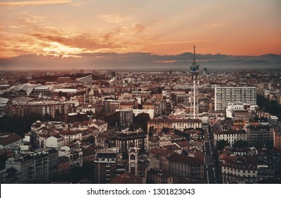 Milan city skyline viewed from above at sunset in Italy.