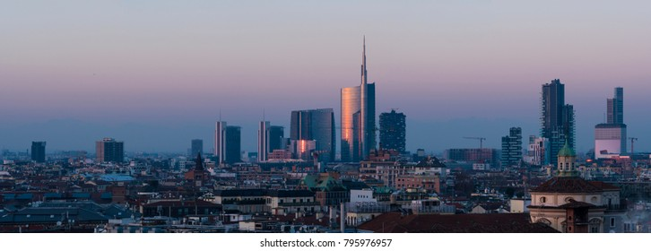 Milan cityscape at sunset, large panoramic view with new skyscrapers of Porta Nuova district