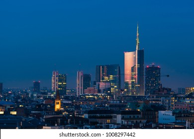 Milan cityscape at sunset with new skyscrapers of Porta Nuova financial and business district