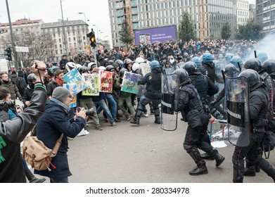 Milan, december 12, 2014 - Police in full riot gear charge on protesting students at the end of the march in solidarity with the general strike called by Unions in Rome and Turin.