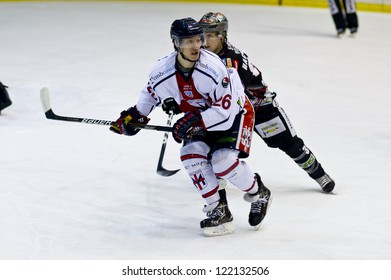 MILAN, DECEMBER, 15 :Tommaso Goi ( White) during H.C. Milan - H.C. Renon Sport  in Italian Ice Hockey Premier League on December 15, 2012, Milan
