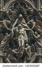 Milan, Italyю Detail Of Facade Of Milan Cathedral Or Duomo Di Milano Is The Cathedral Church Of Milan, Italy. Christ Crucifix.