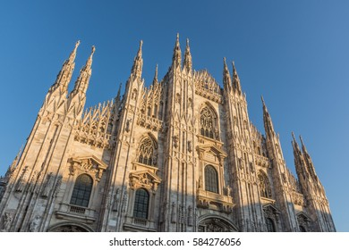 Milan Duomo Cathedral facade during the sunset, Italy