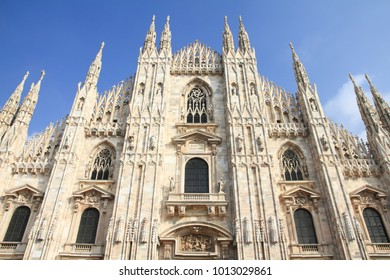 Milan Duomo - the Cathedral. Gothic style marble church facade.