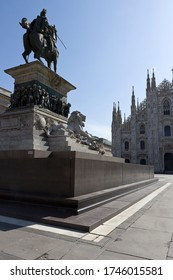 Milan - Duomo square,monument  of Vittorio Emanuele II in front of gothic Duomo facade. During coronavirus epidemic period. Lombardy Italy