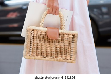 c7aa589a63db MILAN - FEBRUARY 19  Woman poses for photographers with wicker bag and pink  dress before