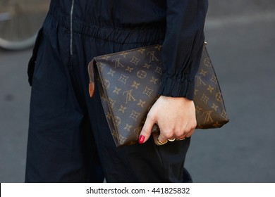 dbd2cb3b2 MILAN - FEBRUARY 20: Woman poses for photographers with Louis Vuitton bag  before Fendi fashion
