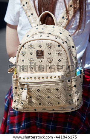 4669ff1d1180 MILAN - FEBRUARY 20: Woman poses for photographers with beige MCM leather  backpack with studs before Gucci fashion show, Milan Men's Fashion Week  street ...