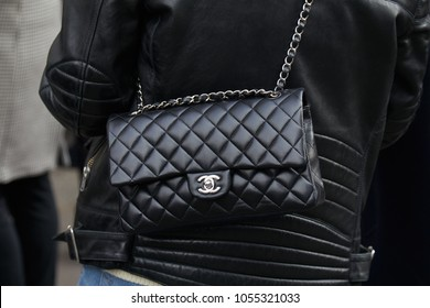 MILAN - FEBRUARY 21: Woman with black Chanel leather bag and jacket before fashion Albino Teodoro show, Milan Fashion Week street style on February 21, 2018 in Milan.