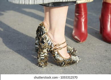 b9b5f9ffcd8 MILAN - FEBRUARY 21  Woman with golden sequin high heel shoes in sunlight before  Gucci