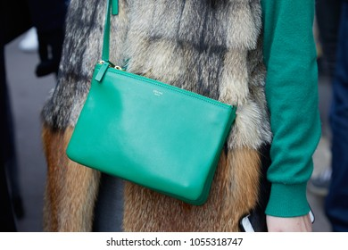 MILAN - FEBRUARY 21: Woman with green leather Celine bag and beige and brown fur coat before fashion Albino Teodoro show, Milan Fashion Week street style on February 21, 2018 in Milan.