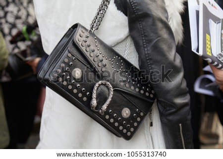 a0946347b26 MILAN - FEBRUARY 21  Woman with Gucci black leather bag with studs  decoration before Gucci