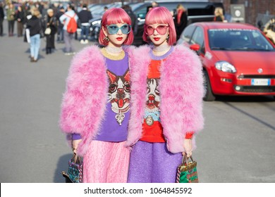 MILAN - FEBRUARY 21: Women with pink fur coat and hair before Gucci fashion show, Milan Fashion Week street style on February 21, 2018 in Milan.