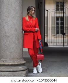 """MILAN - FEBRUARY 22, 2018: Fashionable woman posing for photographers in """"Corso Magenta"""" 24 before EMILIO PUCCI fashion show, Milan Fashion Week Woman fall/winter 2018/19 in Milan, Italy."""