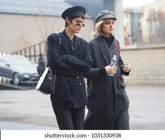MILAN - FEBRUARY 22, 2018: Two fashionable women walking in the street after LES COPINS fashion show, during Milan Fashion Week Woman fall/winter 2018/19 on February 2018 in Milan, Italy.