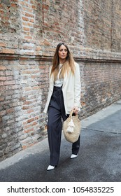 MILAN - FEBRUARY 22: Elisa Taviti with white jacket and black trousers before Max Mara fashion show, Milan Fashion Week street style on February 22, 2018 in Milan.