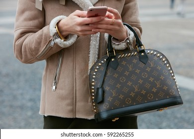 MILAN - FEBRUARY 22: Woman with Louis Vuitton bag and sheep fur coat before Cristiano Burani fashion show, Milan Fashion Week street style on February 22, 2017 in Milan.