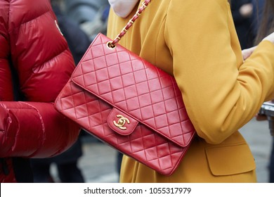 MILAN - FEBRUARY 22: Woman with red Chanel leather bag and yellow jacket before Max Mara fashion show, Milan Fashion Week street style on February 22, 2018 in Milan.