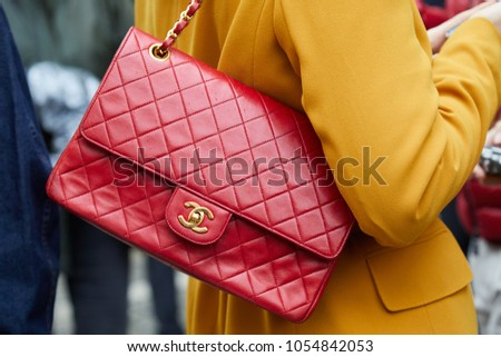 01a772aeaba9 MILAN - FEBRUARY 22  Woman with red Chanel leather bag and yellow jacket before  Max