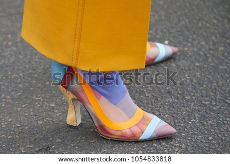 f17fc1d3fe2 MILAN - FEBRUARY 22  Woman with yellow trousers and colorful transparent high  heel shoes before