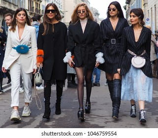 MILAN - FEBRUARY 24, 2018: Fashion bloggers walking for photographers in the street after ERMANNO SCERVINO fashion show, during Milan Fashion Week Woman fall/winter 2018/19 in Milan, Italy.