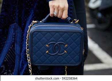 MILAN - FEBRUARY 24: Woman with blue Chanel leather bag before Tod's fashion show, Milan Fashion Week street style on February 24, 2017 in Milan.
