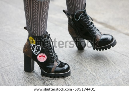 bc18d9909739 MILAN - FEBRUARY 24  Woman with Louis Vuitton high heel boots before  Emporio Armani fashion